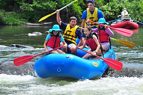 Famiy enjoying a rafting trip down the Youghiogheny River
