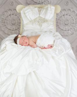 Newborn on wedding dress