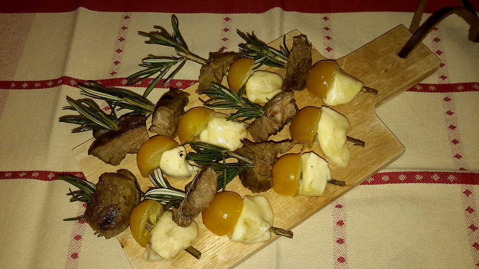 Barbecued lamb on rosemary skewers