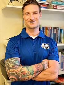 Health coaching - blue shirt, arms cross