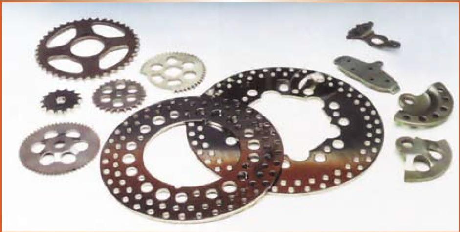 Fig. 3 – Peças utilizadas pela indústria automotiva obtidas pelo processo de corte fino (fonte: Schuler, 1998)
