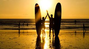 surfing in batubolong beach