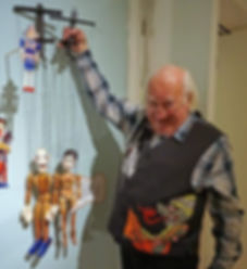 Philip Sugg holding some puppets that he made in Sussex (Brighton)