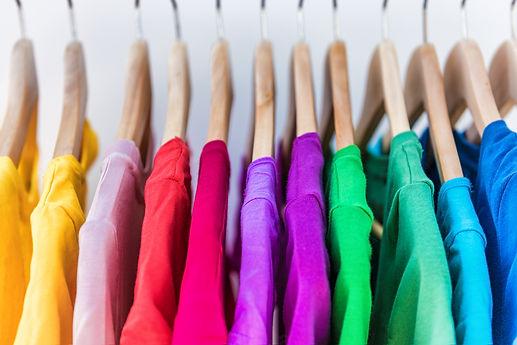 Fashion clothes on clothing rack - brigh