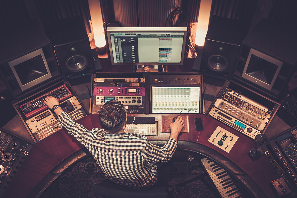 Sound engineer working at mixing panel i