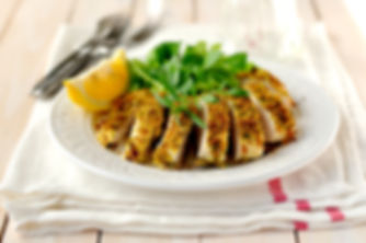 Sliced lemon herb crusted chicken breast