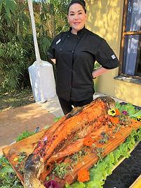 Serving a Cedar Plank baked Salmon
