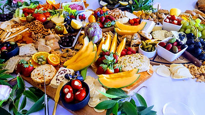 Grazing table with meats fruit cheese .j