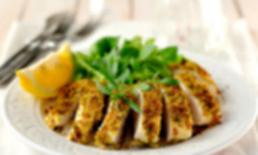 Sliced lemon herb crusted chicken breast