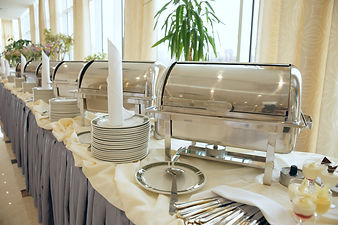 Buffet Table with dishware waiting for g
