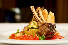 Grilled lamb served on cous-cous with su