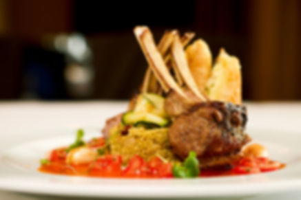 Grilled lamb served on cous-cous, sauce