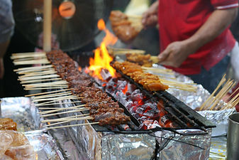 Delicious tasty skewers of chicken cook