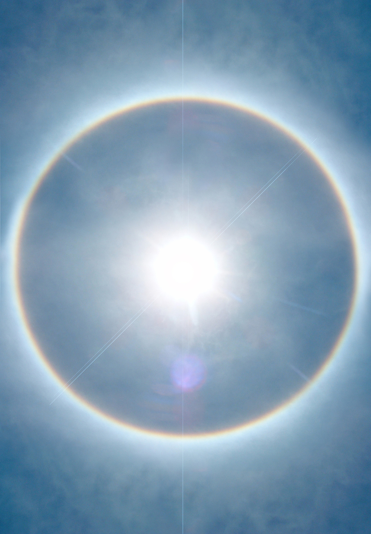 sun-with-rainbow-halo-1517520-1279x1841.jpg