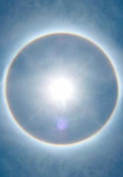 sun-with-rainbow-halo-1517520-1279x1841.jpg