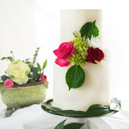 clean white cake with pink/red roses