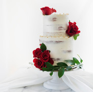 semi naked cake with red roses