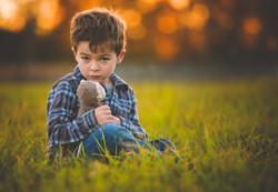 Boy with Stuffed Monkey