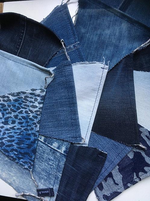 Vlaggenslinger van ca. 300 cm. van oude jeansbroeken!