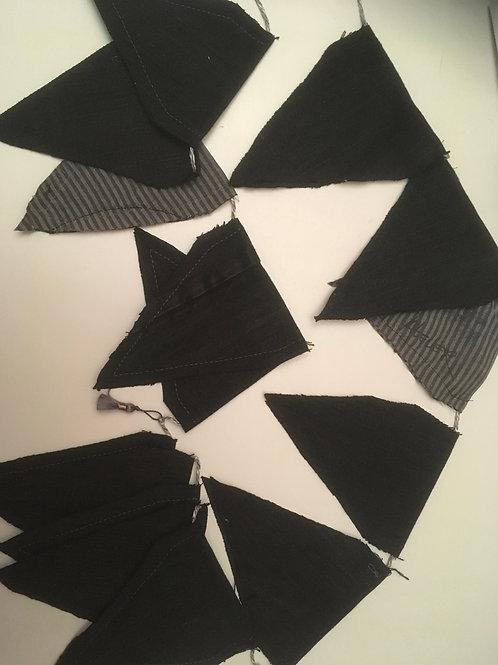 Vlaggenlijn van oude zwarte jeans