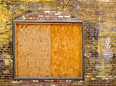 boarded-up-window-old-exterior-brick.jpg