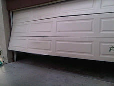 garage door damage.jpeg