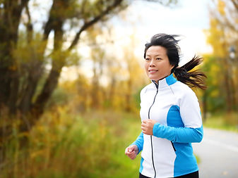 Active woman in her 50s running and jogg