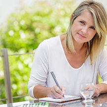 middle aged blond woman working at home