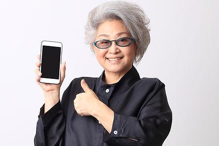 The Asian senior woman on the white back