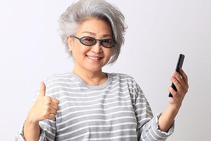 The senior Asian woman on the white back