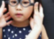 Asian Little Chinese Girl Doing Eyes Examination at An Optical Shop.jpg