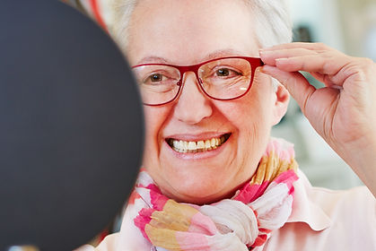 Nearsighted senior woman with new glasse