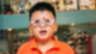 Portrait of a young Asian boy wearing tr