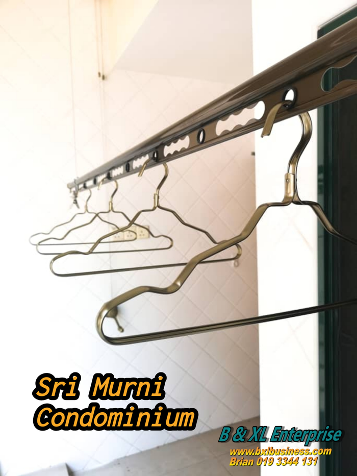 Ceiling mounted lifting clothes hanger.P