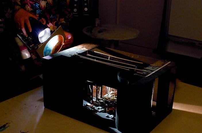 Light shining into a model box of a set design