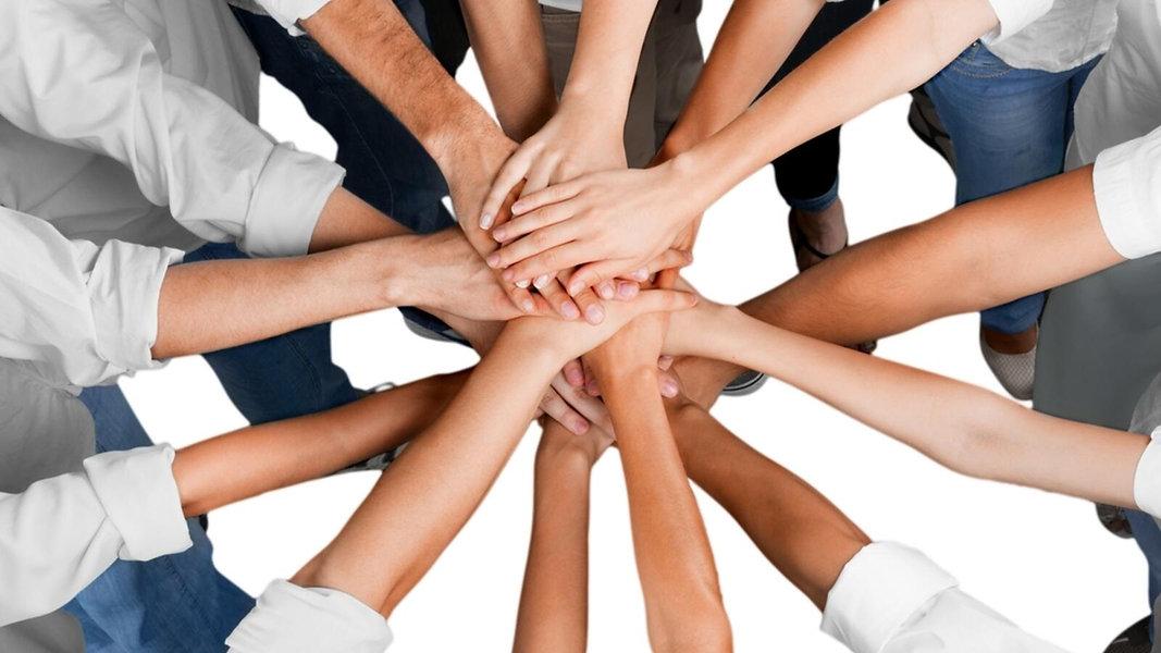 teamwork-hands-shutterstock_288464495.jp