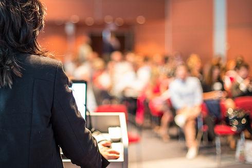Female speaker giving a talk on corporat