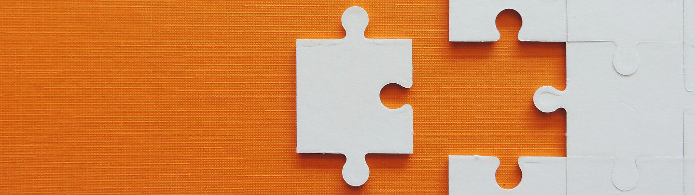 Puzzle jigsaw on orange background..jpg