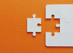 Puzzle jigsaw on orange background..jpg
