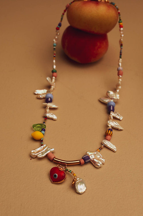 Red heart evil eye necklace