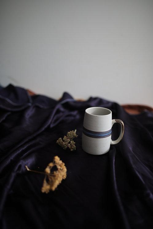 ceramic mug with blue stripe detail