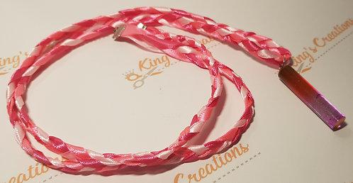 Tubular ribbon pendant