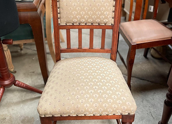 A Set of 4 Antique Hand-Carved Upholstered Dining Chairs with Castors