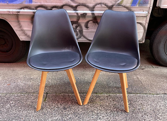A Modern Pair of Black Retro Mid-Century Chairs with Black Vinyl Seat