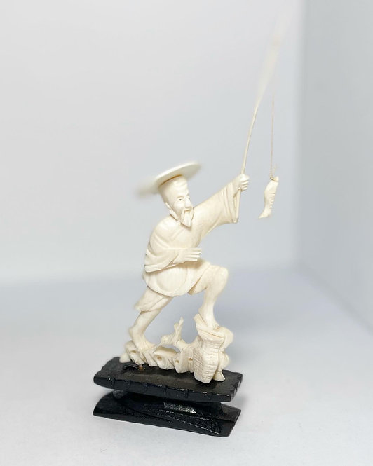 Vintage Detailed Japanese Figurine of a Fishing Man with Pole and Fish