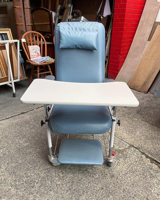 Large Vintage Blue Upholstery Hospital Chair with a Swing Away Chair Table