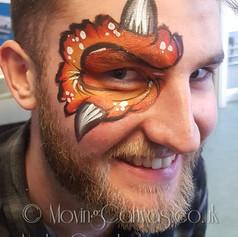 Monster eye design adult face paint