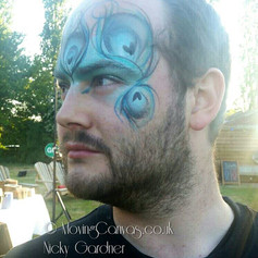 Peacock feather mask face paint