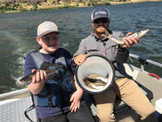 Layne Peters and Issac Krantz showing off their Pikeminnow