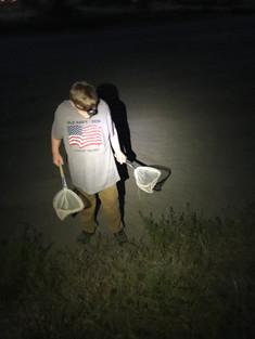 Issac Krantz hunting for crickets